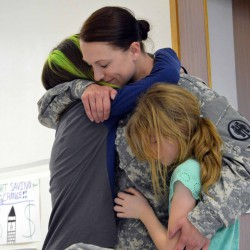 Mom returns from 11-month deployment, surprises two daughters at West Kearns Elementary