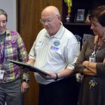 Photo of Kennedy Jr High principal receiving Patriot Award