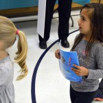 Photo of Jackling Elementary student holding new book