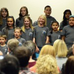 Photo of student choir singing during board meeting