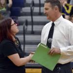 Photo of superintendent announcing Skyline High teacher as Teacher of the Year