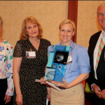 Photo of teacher receiving Sorenson Legacy Award