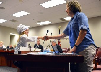 Photo of Elk Run student shaking hands with board member