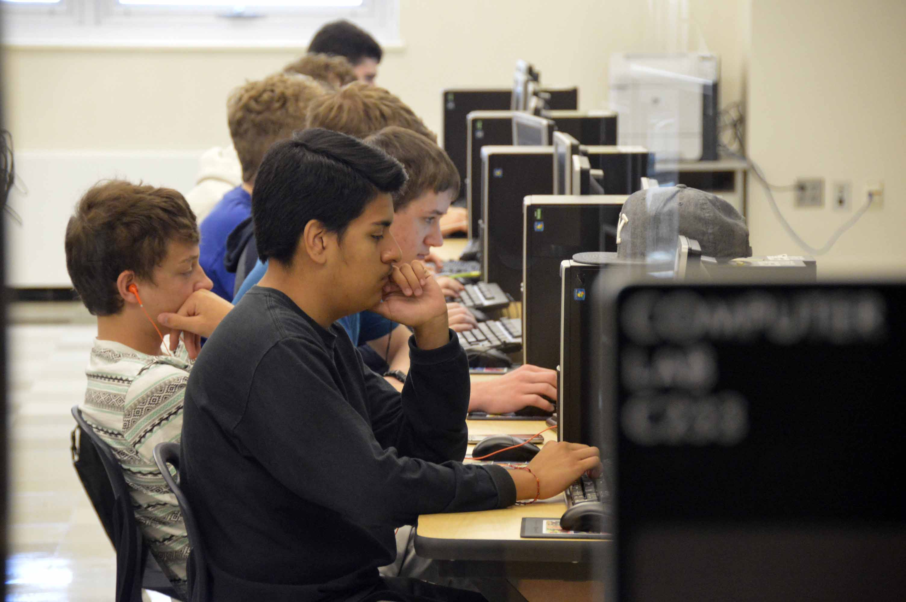handful of students trade summer play for computer code training high school students coding in computer lab