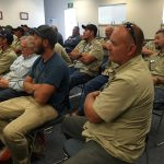 Maintenance employees gathered in conference room
