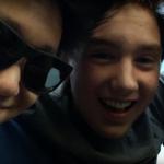 Three Olympus Jr. student looking at camera