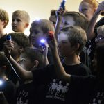 Rosecrest Elementary students sing during board meeting