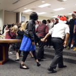 Whittier Elementary students dance and sing during board meeting