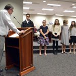 Individual state champions are recognized during board meeting