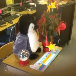 Stuffed penguin sits on Hunter Elementary desk