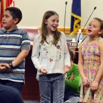 Bridger Elementary student sing during board meeting