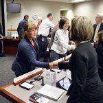Granite Park Jr. High staff shake hands with board members