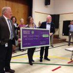 Teacher receives Excel Award in auditorium