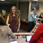 Academic All-State recipients shake hands with board members.