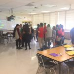 Kearns Jr. students gathered at the center of a classroom