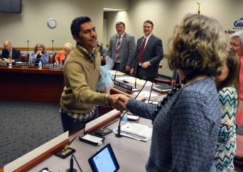Taylorsville High student shaking hands with board members