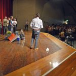 Audience applauds Bennion Jr High student on stage