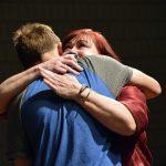 Bennion Jr High staff member hugs student