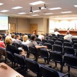 Patrons seated during board meeting