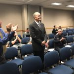 Chief Randy Johnson stands during board meeting
