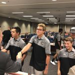 Cottonwood High baseball team shaking hands with board members
