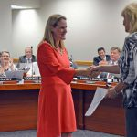 Carrie Johnson shaking hands with Salt Lake County Clerk