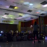 Hunter Elementary students hold up flashlights and glows ticks
