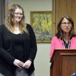 Sarah Wilson and Kandi Barber addressing the board